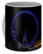 London Eye All Done Up In Blue Light In The Night With A Small Reflection In The Thames Coffee Mug