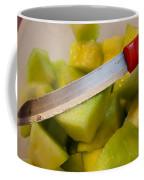 Macro Photo Of Knife Over Bowl Of Cut Musk Melon Coffee Mug
