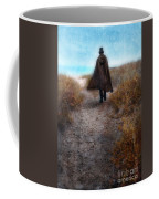 Man In Cape And Top Hat By The Sea Coffee Mug