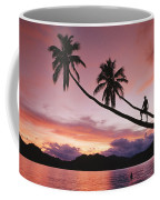 Man, Palm Trees, And Bather Silhouetted Coffee Mug