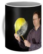 Man Popping A Balloon Coffee Mug