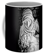 Mary Cradling Jesus Coffee Mug