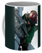 Mechanic Inspects An Mh-60r Sea Hawk Coffee Mug by Stocktrek Images