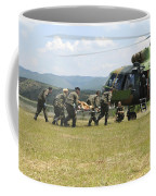 Medical Personnel Carry A Wounded Coffee Mug
