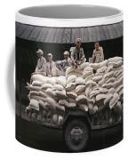 Men Sit On Bags Of Flour Coffee Mug by Justin Guariglia