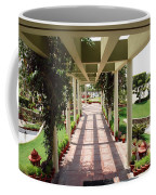 Mix Of Light And Shade Under A Partially Covered Pathway With Pillars Coffee Mug