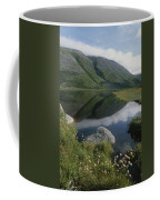 Mountains And Clouds Are Reflected Coffee Mug