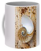Nautilus Shell On Rusty Table Coffee Mug