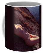 Nude Woman Lying On Rocks By The Water Coffee Mug