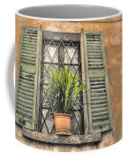 Old Window And A Green Plant Coffee Mug
