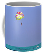 Parasailing Over The Green Water Of The Arabian Sea In The Lakshadweep Islands Coffee Mug