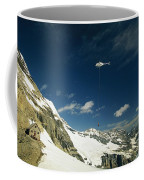 Person Dangles From A Helicopter Coffee Mug by Michael Melford