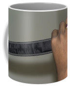 Person Holding A Strip Of Photo Negatives Coffee Mug