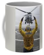 Petty Officer Guides An Sh-60r Sea Hawk Coffee Mug
