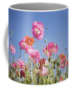Pink Flowers Against Blue Sky Coffee Mug