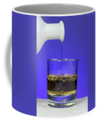Pouring Oil Into Vinegar Coffee Mug by Photo Researchers, Inc.