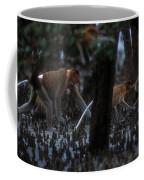 Proboscis Monkeys Travel Over Mangrove Coffee Mug by Tim Laman
