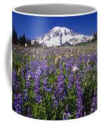 Purple Flowers Blooming Beneath Mount Coffee Mug