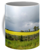 Rain Clouds Over Canola Field Coffee Mug