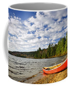 Red Canoe On Lake Shore Coffee Mug