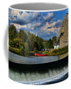 Red Canoes At The Boathouse Coffee Mug by Paul Ward