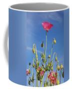 Red Flower Against Blue Sky Coffee Mug