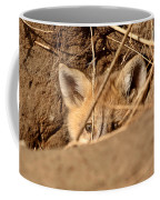 Red Fox Pup Peaking Out Of Den Coffee Mug