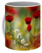 Red Poppies And Small Daisies Bloom Coffee Mug by Annie Griffiths