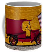 Red Truck Against Yellow Wall Coffee Mug