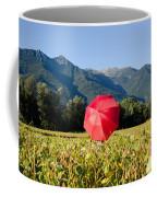 Red Umbrella On The Field Coffee Mug