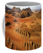 Rock Formations And Sand Near Petra Coffee Mug by Annie Griffiths