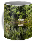 Rowboat Moored On The Bank Of A Lake Coffee Mug