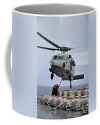 Sailors Hook An Ammunition Pallet To An Coffee Mug