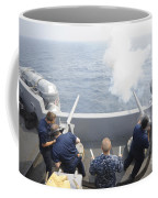 Sailors Perform A 21-gun Salute Aboard Coffee Mug by Stocktrek Images