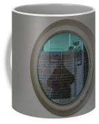 Self Portrait In A Circular Glass On The Wall Coffee Mug