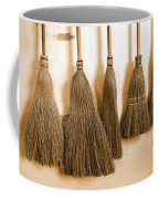 Shaker Brooms On A Wall Coffee Mug