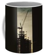 Silhouette Crane At A Skyscraper Coffee Mug