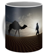 Silhouette Of Berber Leading Camel Coffee Mug