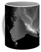 Silhouetted House And Clouds Coffee Mug
