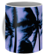 Silhouetted Palm Trees Blow In The Wind Coffee Mug