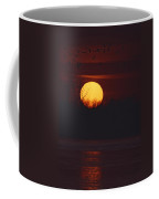 Silhouetted Sandhill Cranes Fly Coffee Mug
