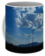 Silhouetted Telephone Poles Under Puffy Coffee Mug