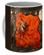 Silver Metal Flower On Orange Coffee Mug
