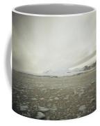 Slush Fills The Sea Under A Cloudy Sky Coffee Mug
