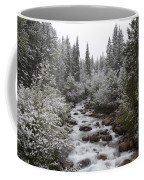 Snowy Foliage Along Stream In Autumn Coffee Mug