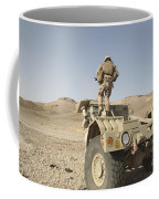 Soldier Climbs A Damaged Husky Tactical Coffee Mug by Stocktrek Images
