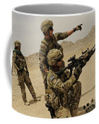 Soldier Directing A Fellow Soldier Coffee Mug