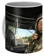 Soldier Monitors The Progress Of A 67 Coffee Mug