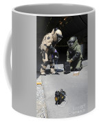 Soldiers Dressed In Bomb Suits Examine Coffee Mug