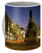 Statue Of A Man On A Pedestal On The Coffee Mug